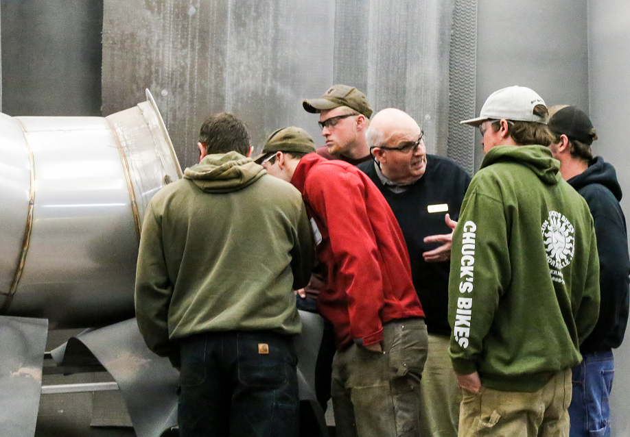 MFG Day visitors look at PSP vent pipe