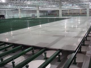 Raised access floor installation in large fabrication space