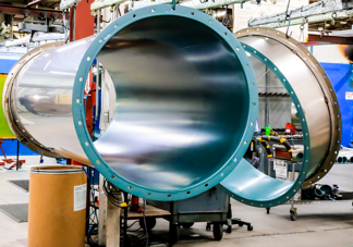 Fluoropolymer coating in stainless steel exhaust duct
